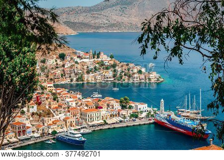 Symi / Greece - August 17 2017: View Of The Port From Above. Symi (or Simi), Is A Tiny Island Of Dod
