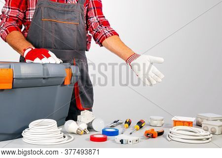 Builder Handyman With Construction Tools. Handyman Showing Equipment For Repair.