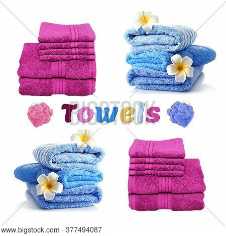 Blue And Purple Clean Ironed Terry Towels Stacked Neatly Against A White Background.