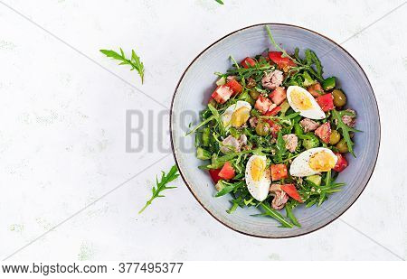Healthy Food. Tuna Fish Salad With Eggs, Cucumber, Tomatoes, Olives And Arugula.  French Cuisine. To