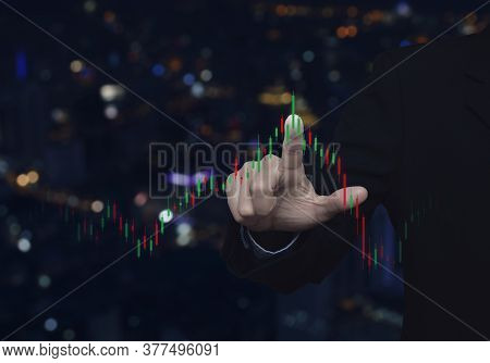 Businessman Pressing To Trading Graph Of Stock Market Over Blur Colorful Night Light Modern City Tow