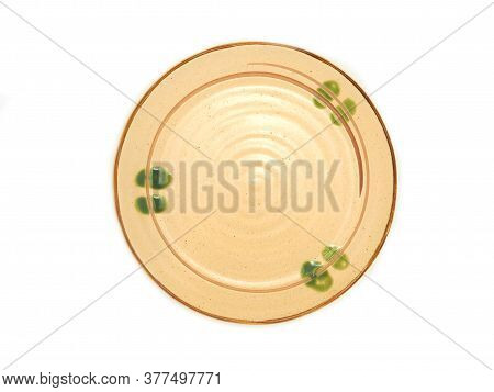 Empty Circle Ceramic Plate With A Brown Rim And Green Pattern Isolated On A White Background. Used F