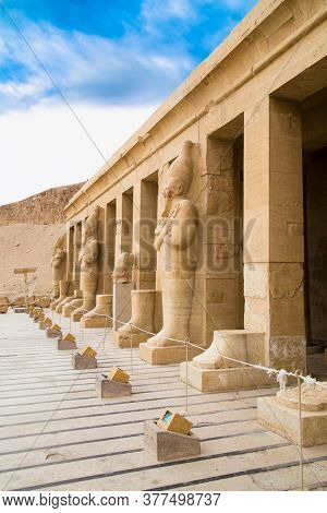Luxor, Egypt - Jan 28, 2020: Statues at Temple of Hatshepsut, Luxor. The Mortuary Temple of Hatshepsut, also known as the Djeser-Djeseru is a mortuary temple of Ancient Egypt
