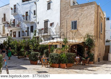 Polignano A Mare, Italy - September 17, 2019: The Charming And Romantic Historic Old Town Of Poligna