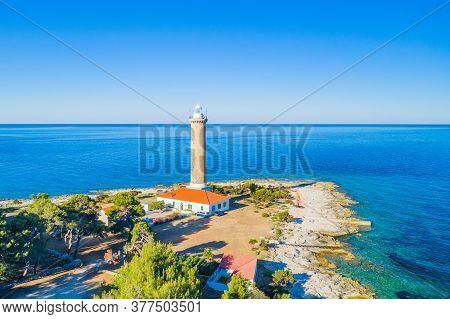 Sunrise Over Lighthouse Of Veli Rat On The Shore On The Island Of Dugi Otok, Croatia, Beautiful Seas