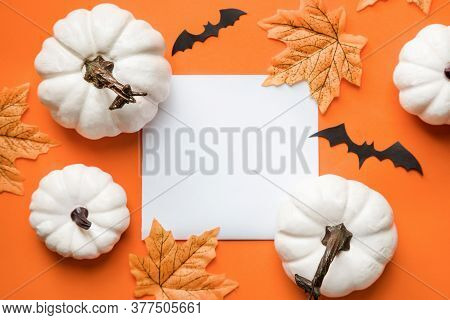 Happy Hallooween Backgroung. Flat Lay Composition On Orange Paper.