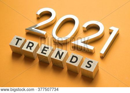 Wooden Blocks With The Word Trends And Metal Numbers 2021. Popular , Relevant Topics. New Trends Of