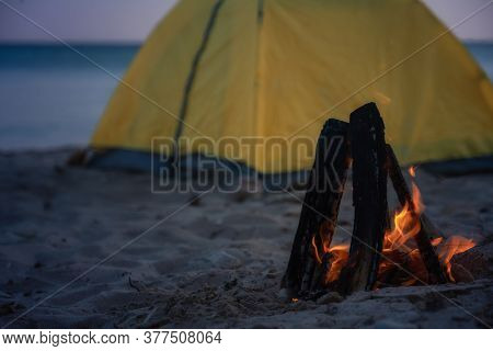 Fire In Bonfire In The Beach . Camping And Tents To Travel
