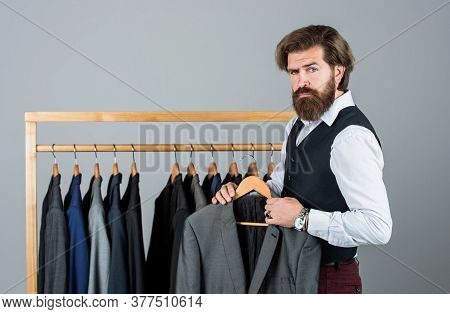 Creating New Fashionable Styles. Man With Suit. Tailor In His Workshop. Handsome Bearded Fashion Man