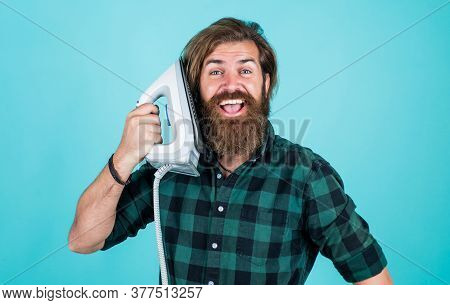 Hello. Bearded Male Housekeeper. Hipster Ironing Clothes. New Technology With High Quality. Homework