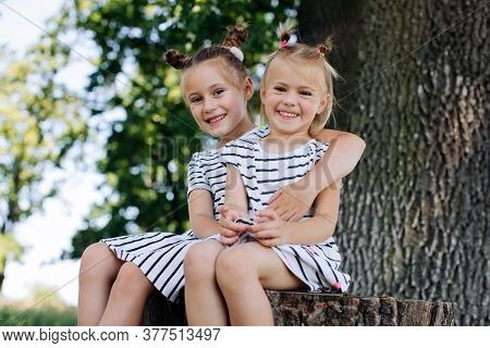 The Sister Takes Care Of Her Younger Sister. The Sisters Hug