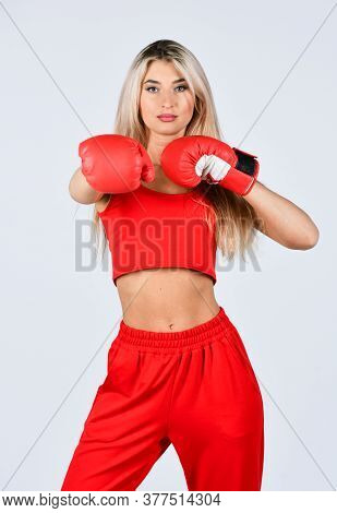 Self Improvement. Sporty Girl Red Clothes Boxing Gloves. Gym And Workout. Fitness Model. Sporty Woma