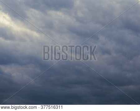Dark Gray Heavy Clouds In The Sky Before A Thunderstorm. Dramatic Gloomy Background Or Wallpaper. Ah