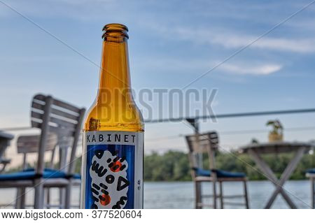 Belgrade / Serbia - August 24, 2019: Kabinet Brewery Craft Beer Bottle, With Bar Chairs And Tables A