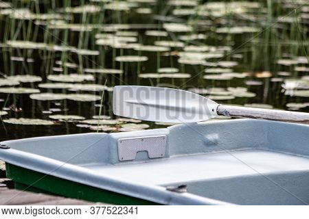 White Boat Oar On A Boat. Recreation By The Lake. Boat Equipment. Recreation By The Lake Or Water Ac