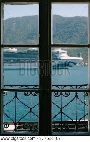 The Cruise Liner Sails In The Window Of The Hotel Room.