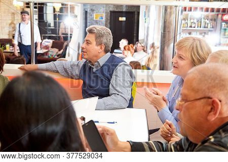 Kirov, Russia - October 02, 2019: People At Table In Cafe Or Restaurant During Intellectual Game. Pe