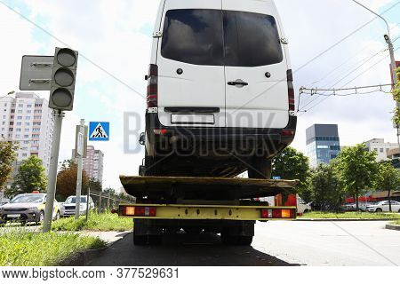 Minibus Is On Tow Truck. Towing And Towing Cars Concept