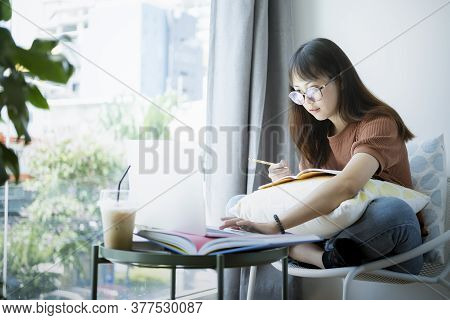 Teen Girl Using Computer Laptop To Self Learning Online.