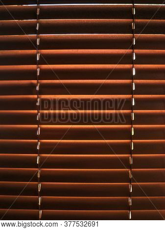 Closed Golden Jalousie Texture With Sunlight In The Morning. Window With Blinds Interior Design Of L