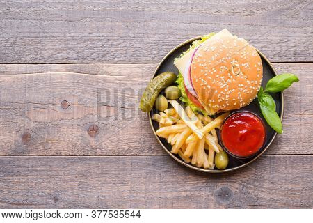 Top View Burgers With Sauce And French Frieson The Wooden Background, Copy Space.