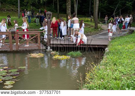 Voevodyno, Ukraine - July 7, 2020: Girls In National Ukrainian Clothes With Wreaths Of Flowers  Cele