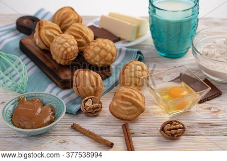 Nuts With Condensed Milk And Ingredients - Milk, Nuts, Chocolate, Egg, Butter, Flour, Cinnamon, Cond