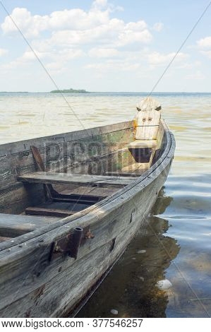 Flat-bottomed Boat On The Lake. Vertical Photo.