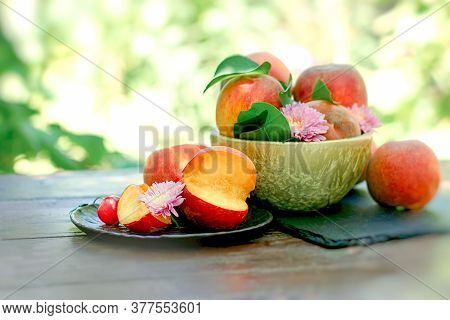 Organic Peach On Plate And In Bowl On Rustic Table