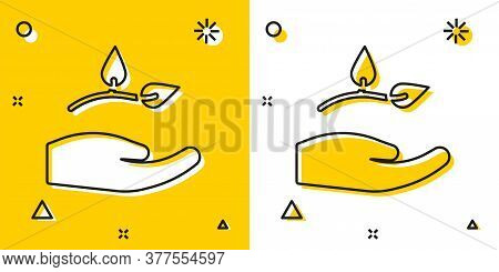 Black Leaf In Hand Of Environmental Protection Icon Isolated On Yellow And White Background. Seed An