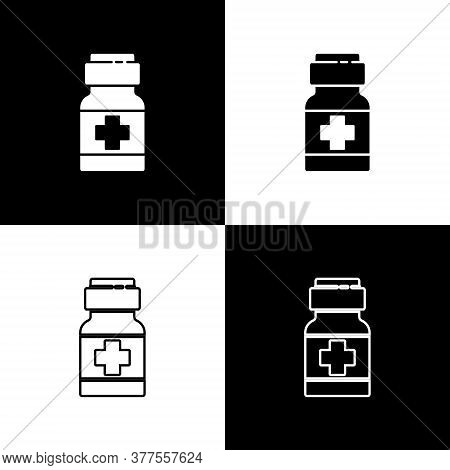 Set Medicine Bottle And Pills Icon Isolated On Black And White Background. Medical Drug Package For