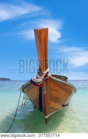 Tropical Sea With Long Tail Wooden Boat Over Turquoise Water On The Beach On Phi Phi Island In South