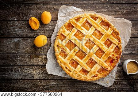 Summer Apricot Or Peach Pie Homemade On Wooden Background, Top View. Delicious Fruit Dessert. Fruit