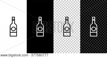Set Line Glass Bottle Of Vodka Icon Isolated On Black And White Background. Vector