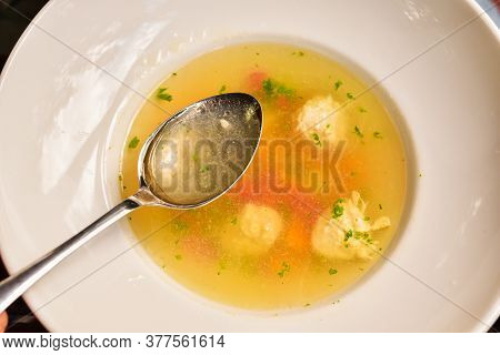 Plate Of Vegetable Soup With Meatballs. Soup With Meatballs And Vegetables. Spoon, Plate, Soup