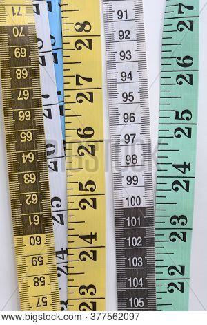 Measuring Tape Set On White Background. Gren White Blue Measuring Tape