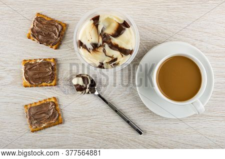 Sandwiches From сrackers With Chocolate-dairy Paste, Teaspoon And Jar With Paste, Cup Of Coffee With