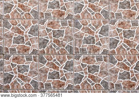 Texture Of A Wall Tiled With A Giraffe Skin Pattern. Abstract Image For The Background.