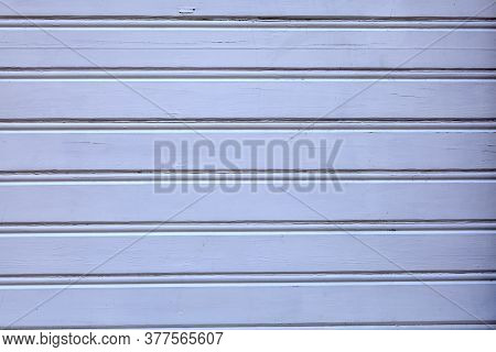 Low Contrast Texture Of A Wooden Wall, White-blue Tint. A Building Clad In Pale Blue Wood Planks, Ab