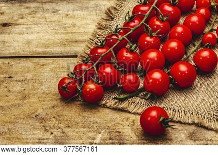 Whole Ripe Cherry Tomatoes On Branch