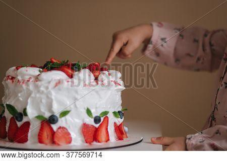 Little Girl First Time Taste Bithday Cake. Cute Little Girl In Beautiful Dress Tasting Cake With Str