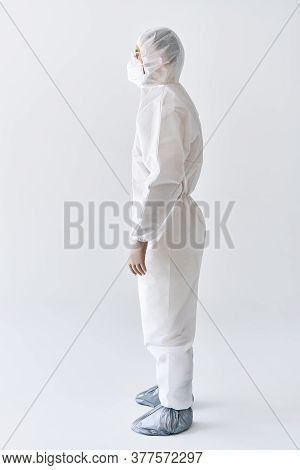 Full Length Portrait Of Doctor Wearing Ppe. Protection Suit