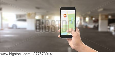 Hand Holding Smartphone Device And Touching Screen, Which Is Icon Of The Location, Concept Of Online