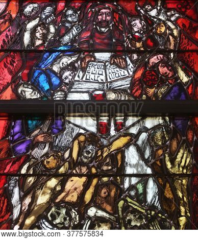 PIFLAS, GERMANY - JUNE 07, 2015: God bears the guilt of all mankind, stained glass window by Sieger Koder in church of Saint John in Piflas, Germany