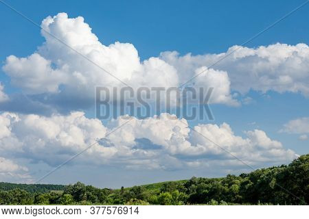 White Clouds Over Green Hills And Forests