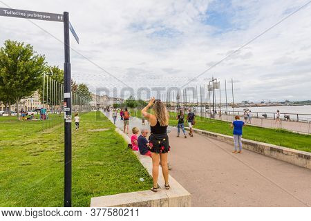 Bordeaux, France - August 18, 2019: People on the streets of Bordeaux. Bordeaux is a port city on the Garonne River in the Gironde department in southwestern France.