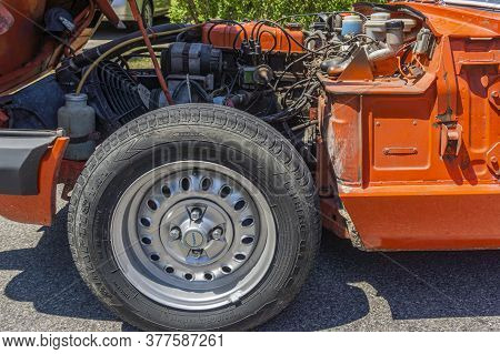 Toronto, Canada, July 2020 - Side View Of A Triumph Spitfire Vintage Car With Open Bonnet Showing Th