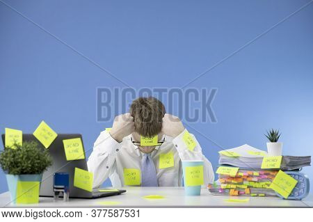 Frustrated Manager Does Not Cope With Deadlines At Work. A Lot Of Work, Paperwork. Everything Is Glu