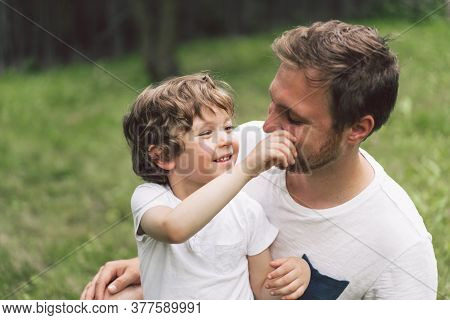 Father And His Son Playing And Hugging In Outdoors. Concept Of Fathers Day. Happy Loving Family.