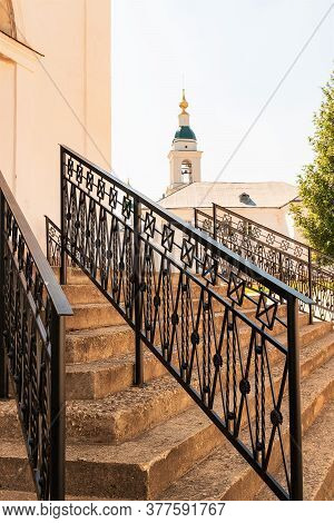Russia,uglich, July 2020. The Staircase Of An Ancient Orthodox Cathedral With Figured Railings.